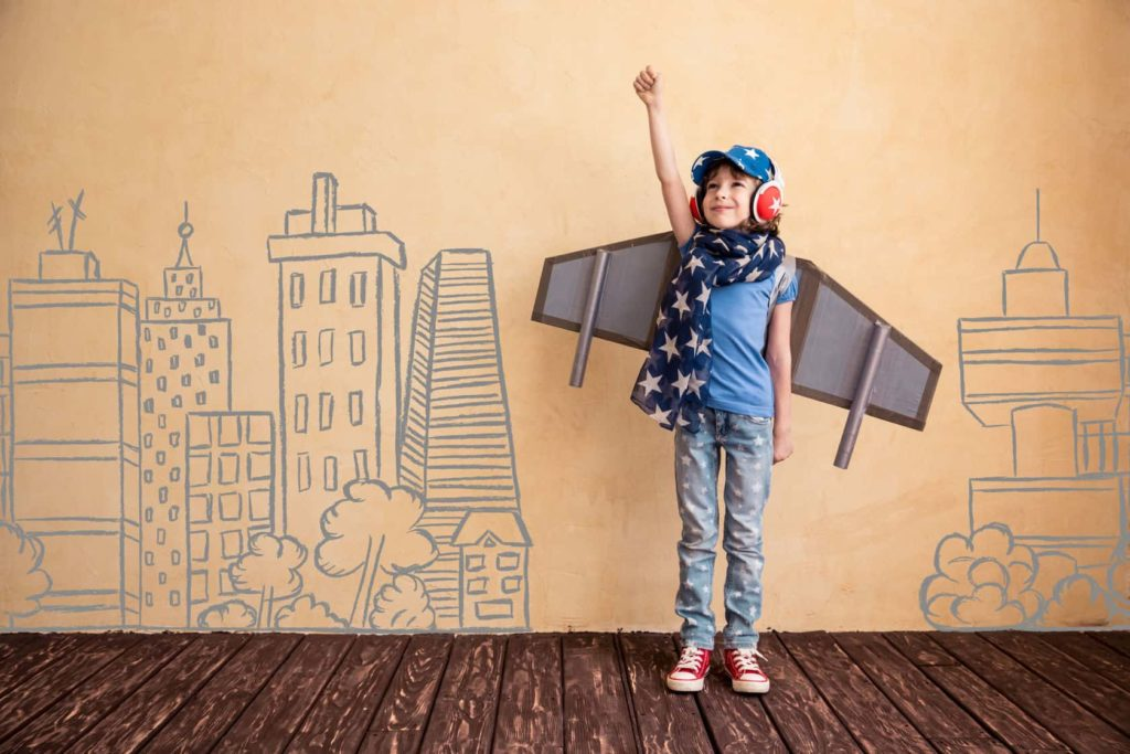 Photo for Autism - Strategies for Self-Regulation, Learning and Challenging Behaviours. Child in creative airplane costume, soaring high