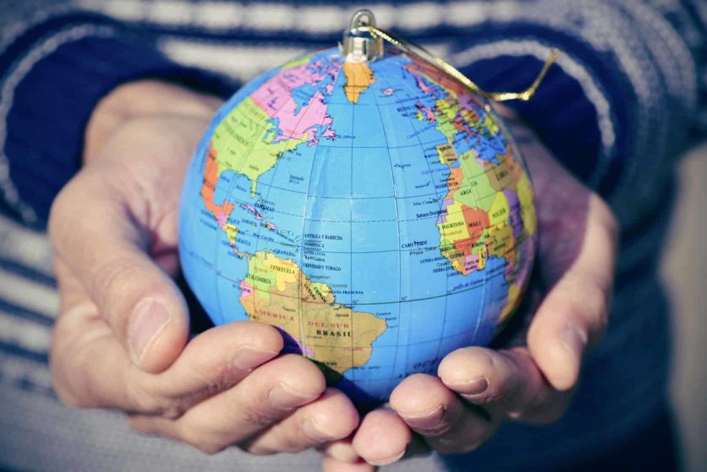 Hands holding the globe. Photo for Refugees and Trauma workshop