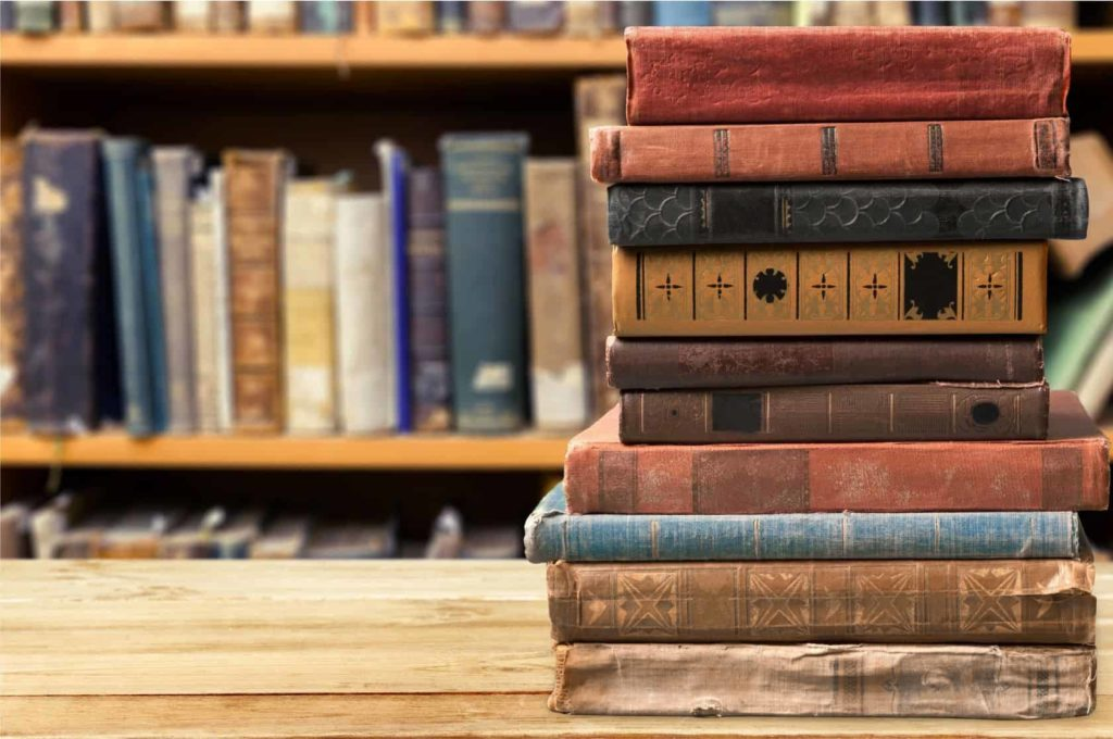 Narrative Therapy Photo of books, old, stacked.