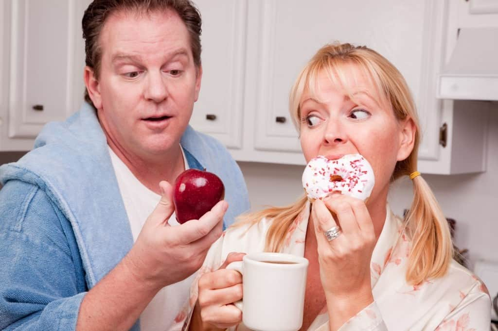 man and woman eating breakfast one is mindful eating
