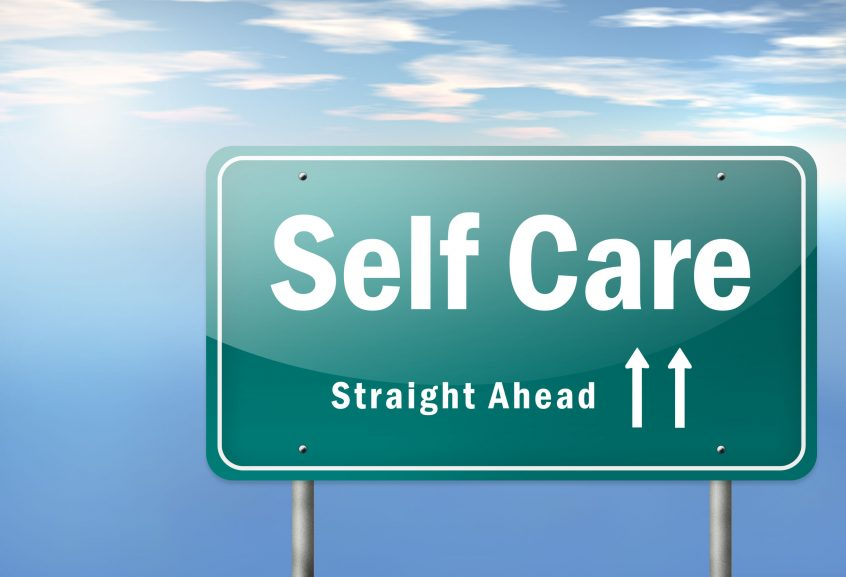 highway signpost with self care wording