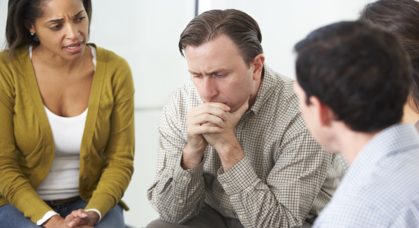 Language Matters – Rethinking How We Talk About People and Problems photo of man thinking in a group