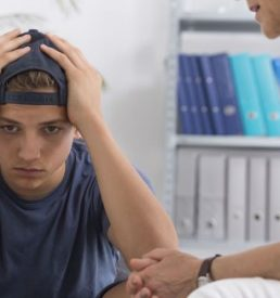 photo of Depressed teenage boy during session with psychologist for Challenging Behaviours in Youth workshop